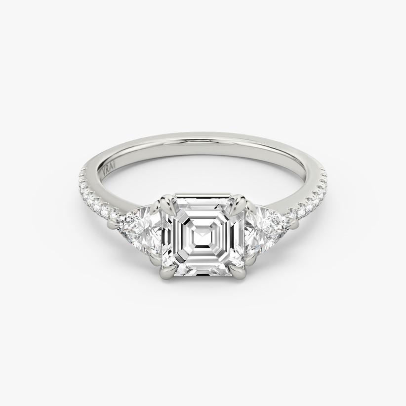 asscher cut three stone engagement ring