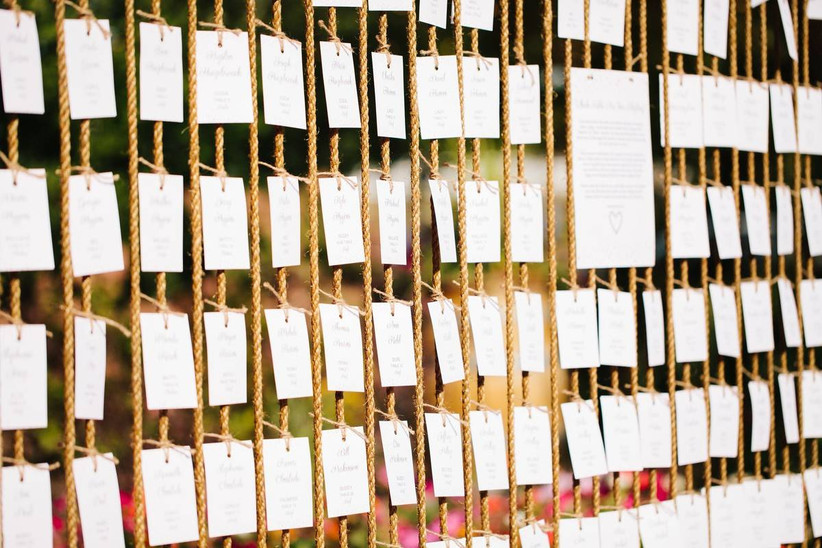 wedding escort cards tied to vertical ropes