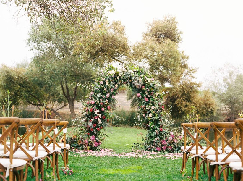 floral wedding arch with greenery and pink flowers
