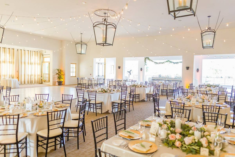 indoor wedding reception space with tables and chairs