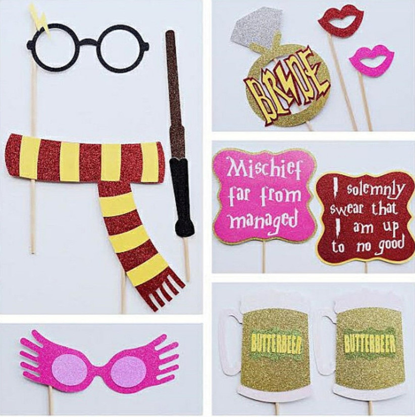 harry potter bachelorette party photo booth props with harry's glasses, wand, gryffindor scarf