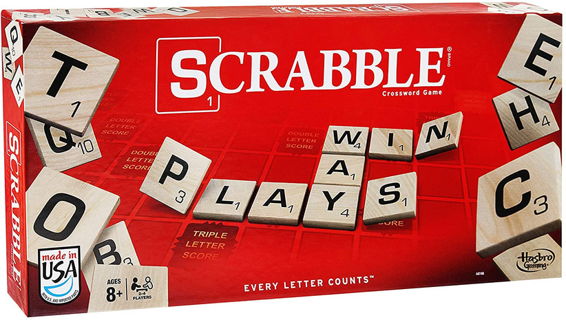 Red Scrabble board game cover shower some of the letter tiles