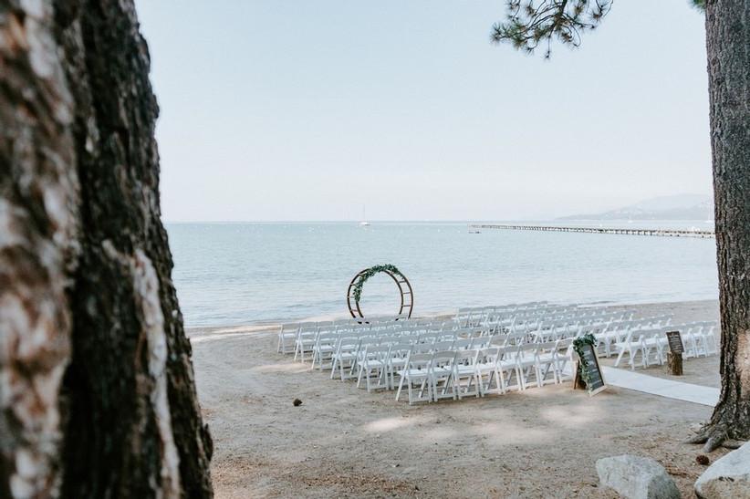 beach wedding ceremony with circular wedding altar