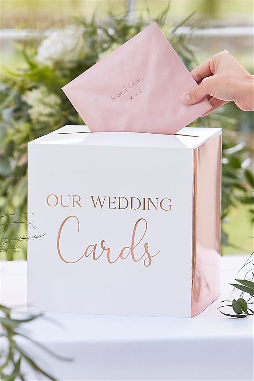 paper wedding card box with metallic rose gold sides and our wedding cards written in rose gold foil on the front