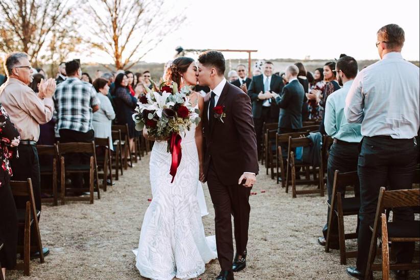 kissing at wedding recessional