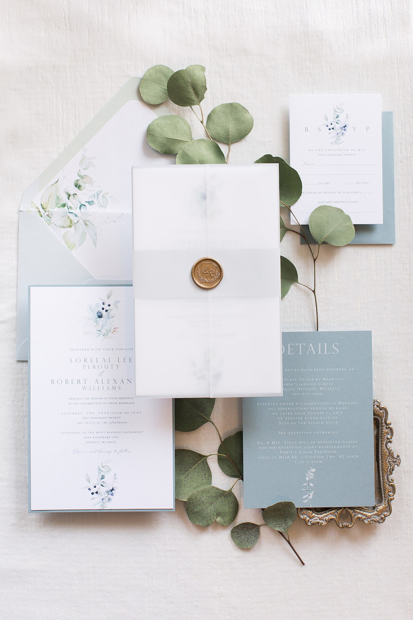 classic spring wedding invitation with blue floral watercolors and gold wax seal