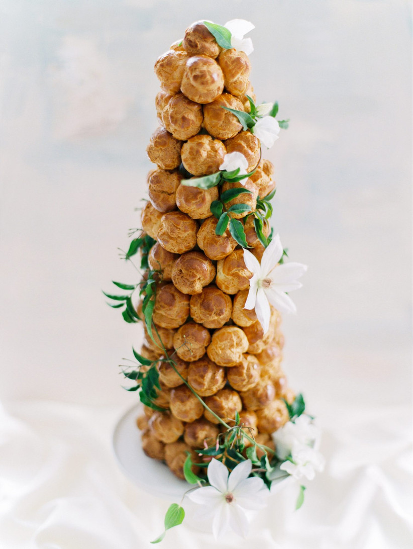 French croquembouche decorated with white clematis flowers and vines