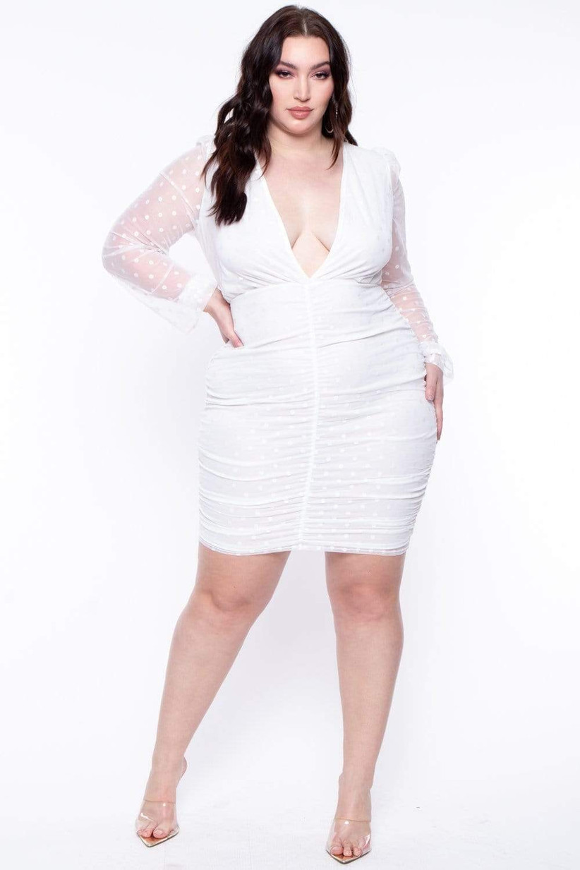 plus-size bachelorette party dress white bodycon style with low v-neckline and sheer sleeves decorated with polka dots