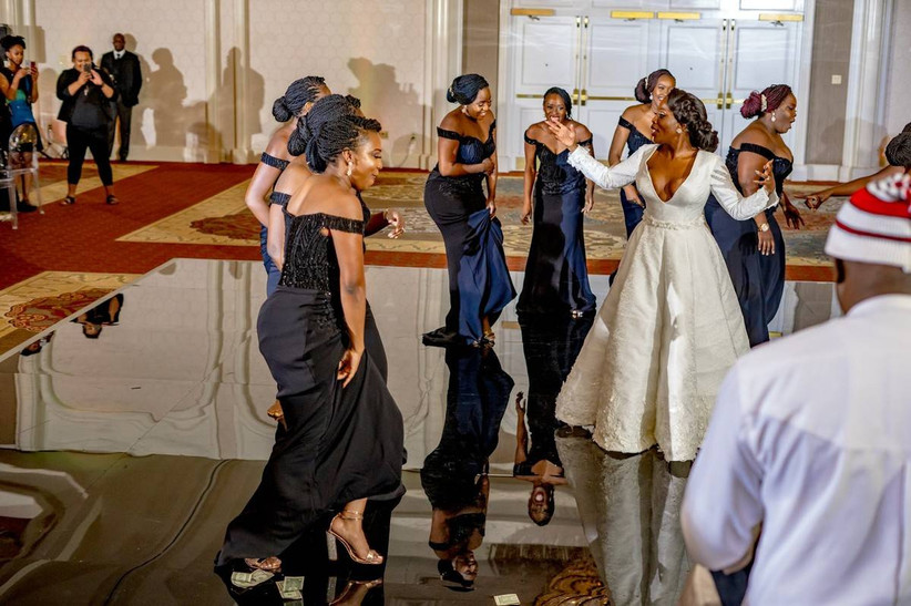 bride and bridesmaids dancing together at wedding