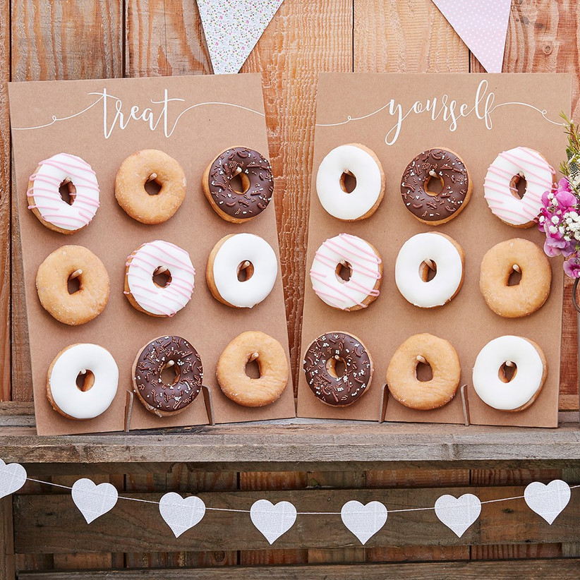 Two donut boards with nine donuts each that read Treat Yourself