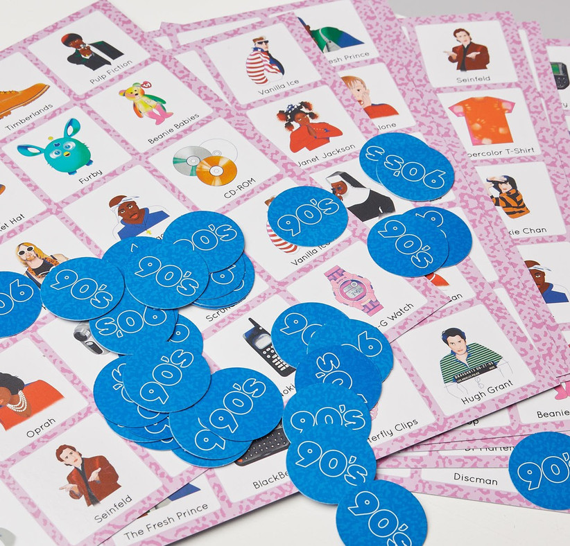 Bingo cards showing various 90s themes such as Sister Act and butterfly clips with blue circular 90s tokens