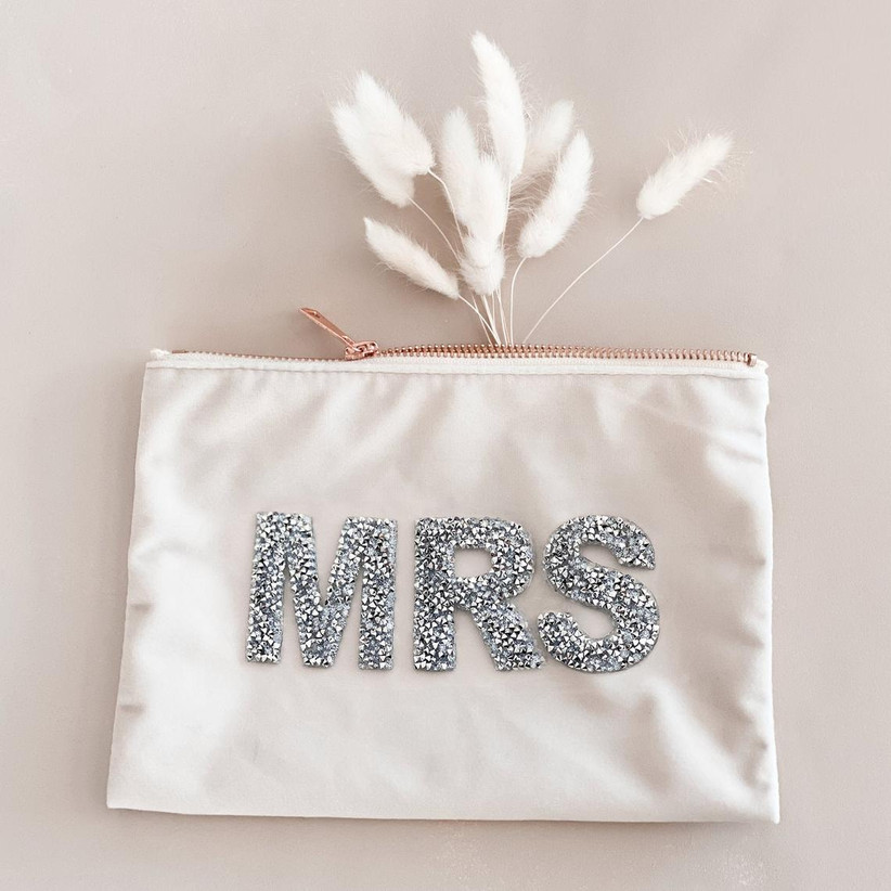 white makeup bag decorated with