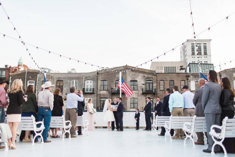 couple stand at the altar at savannah riverboat cruises