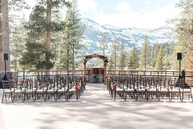 outdoor wedding ceremony with snowy mountain backdrop