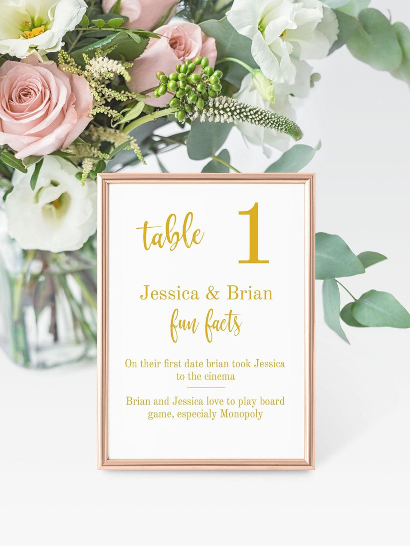wedding table number with trivia in rose gold picture frame