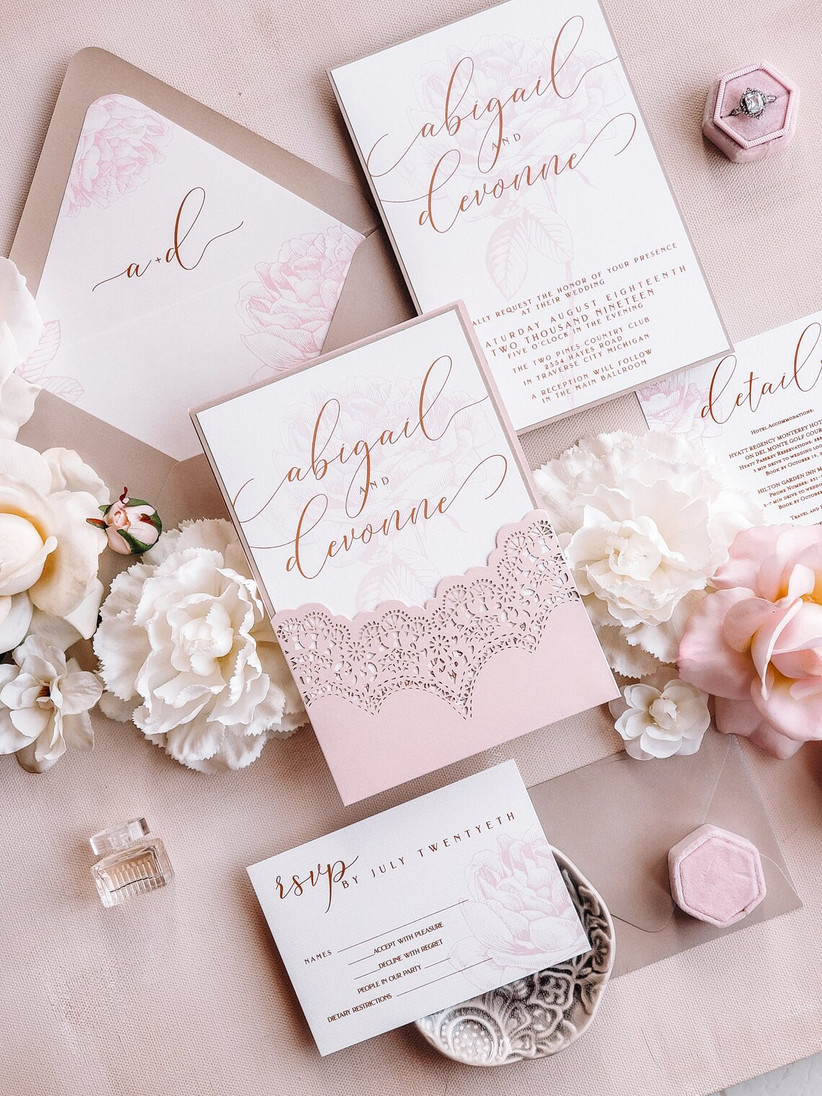 romantic blush pink spring wedding invitations with gold calligraphy and lace laser cut envelope