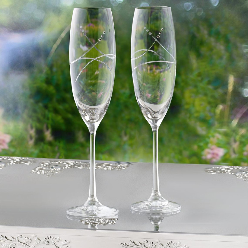Wedding champagne glasses with elegant hand-cut swirls and crystals