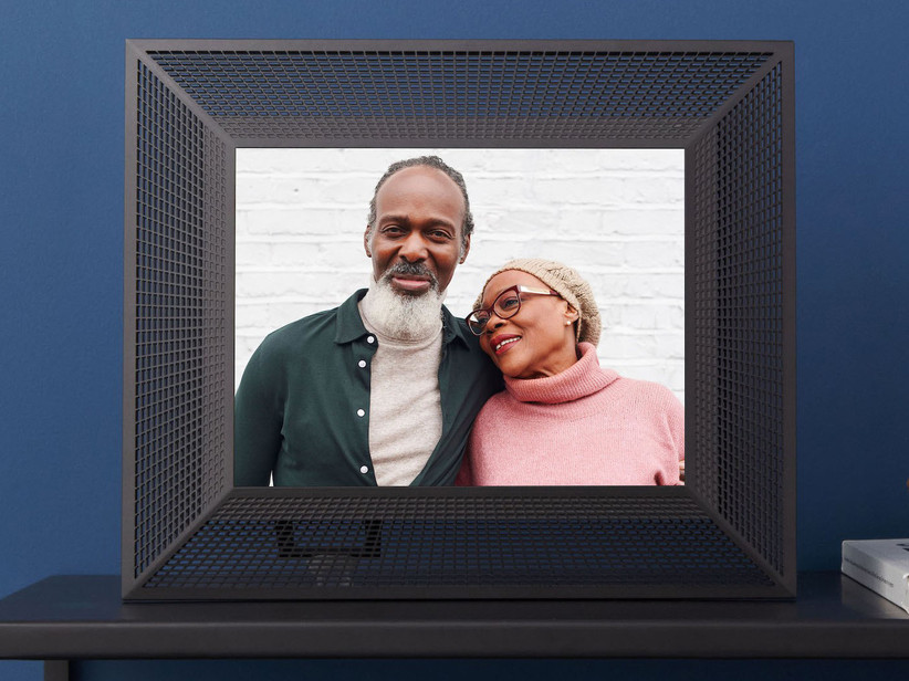 Digital photo frame with black grid design showing image of a couple