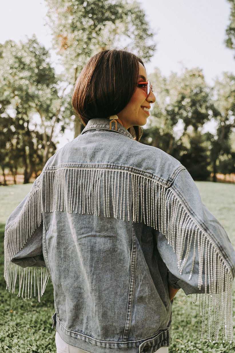 denim bridal jacket with rhinestone fringe across the back of shoulders and down the sleeves