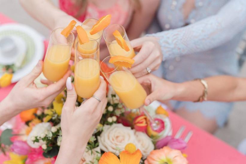 women toasting mimosas