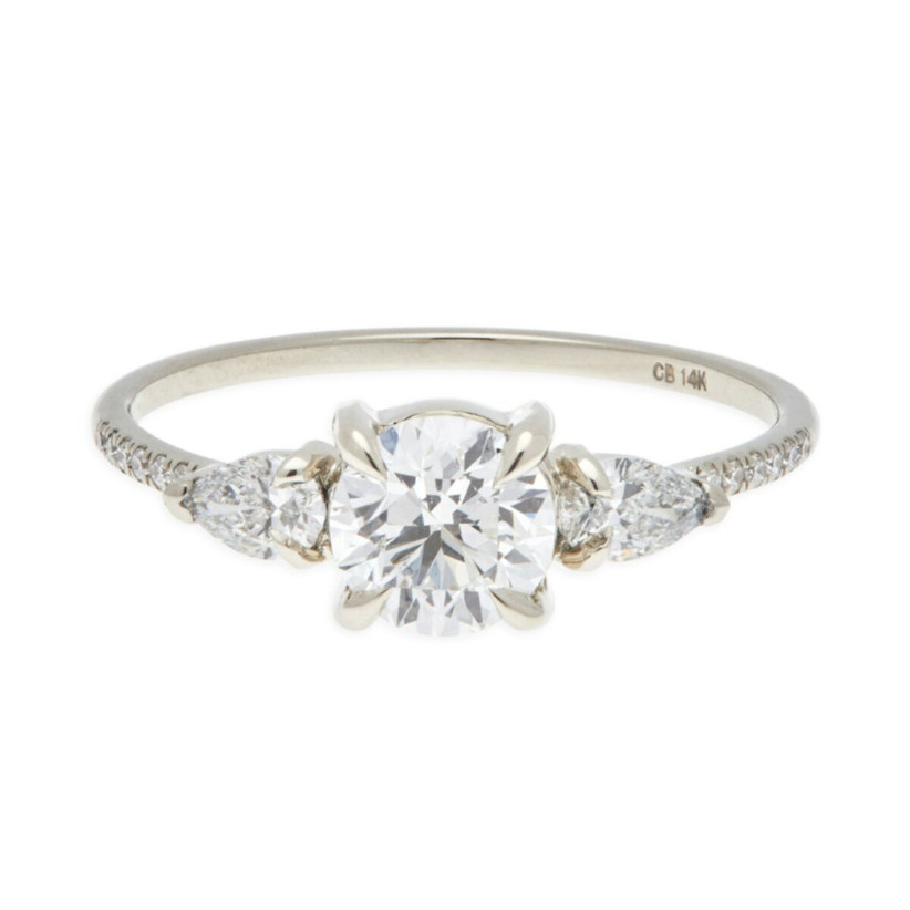 round cut and pear three stone engagement ring