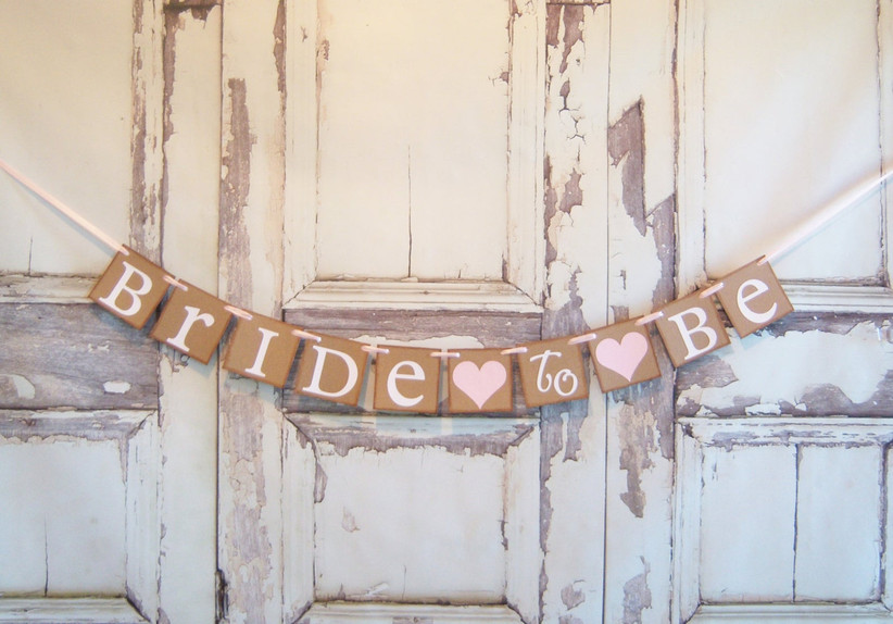 Cardstock Bride to Be banner against a rustic whitewashed backdrop