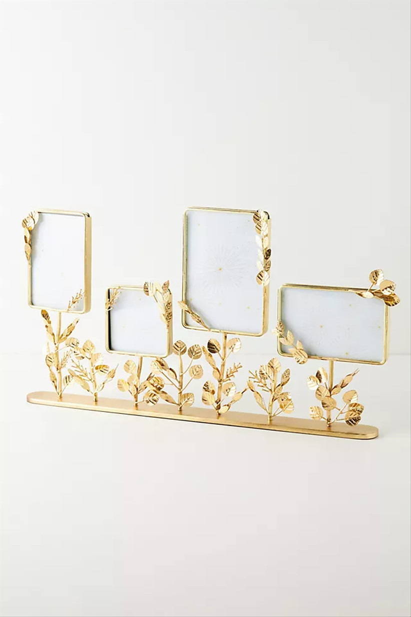set of four gold picture frames decorated with wire leaves