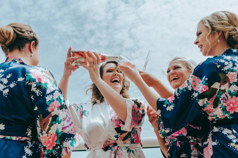 bridesmaids pouring champagne
