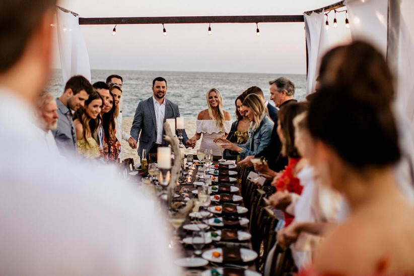couple and guests at rehearsal dinner