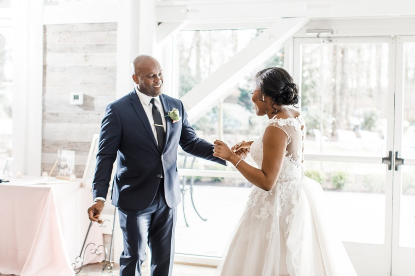 Black bride dances with her dad