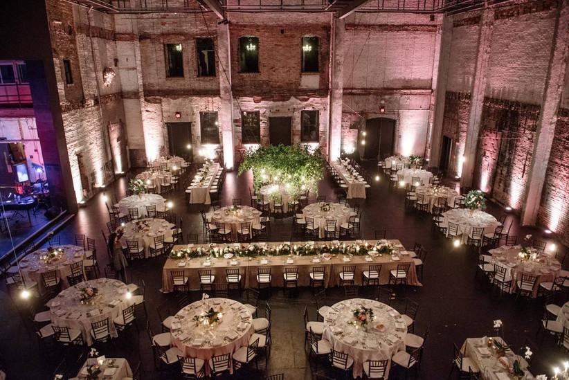 indoor wedding reception in large industrial space