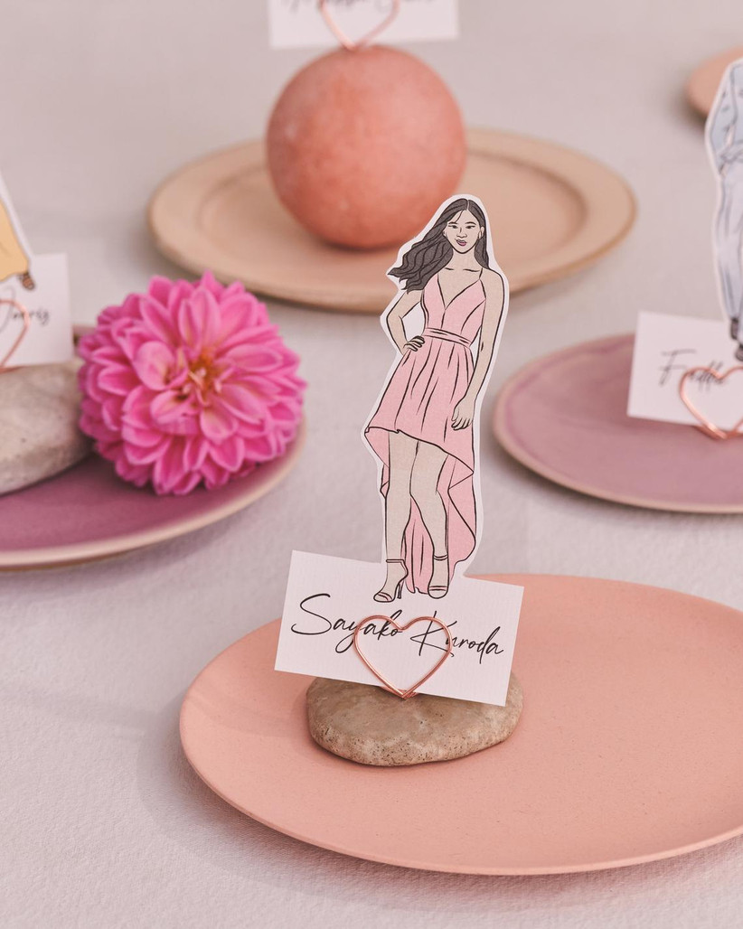 small drawing of a wedding guest is displayed on an empty plate