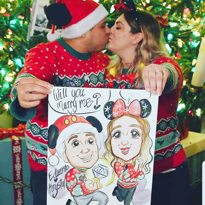 couple wearing matching christmas sweaters with caricature proposal