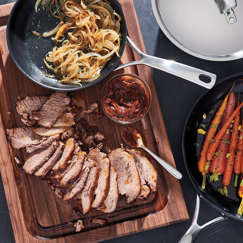 Succulent meat on a serving tray with vegetables in a pan