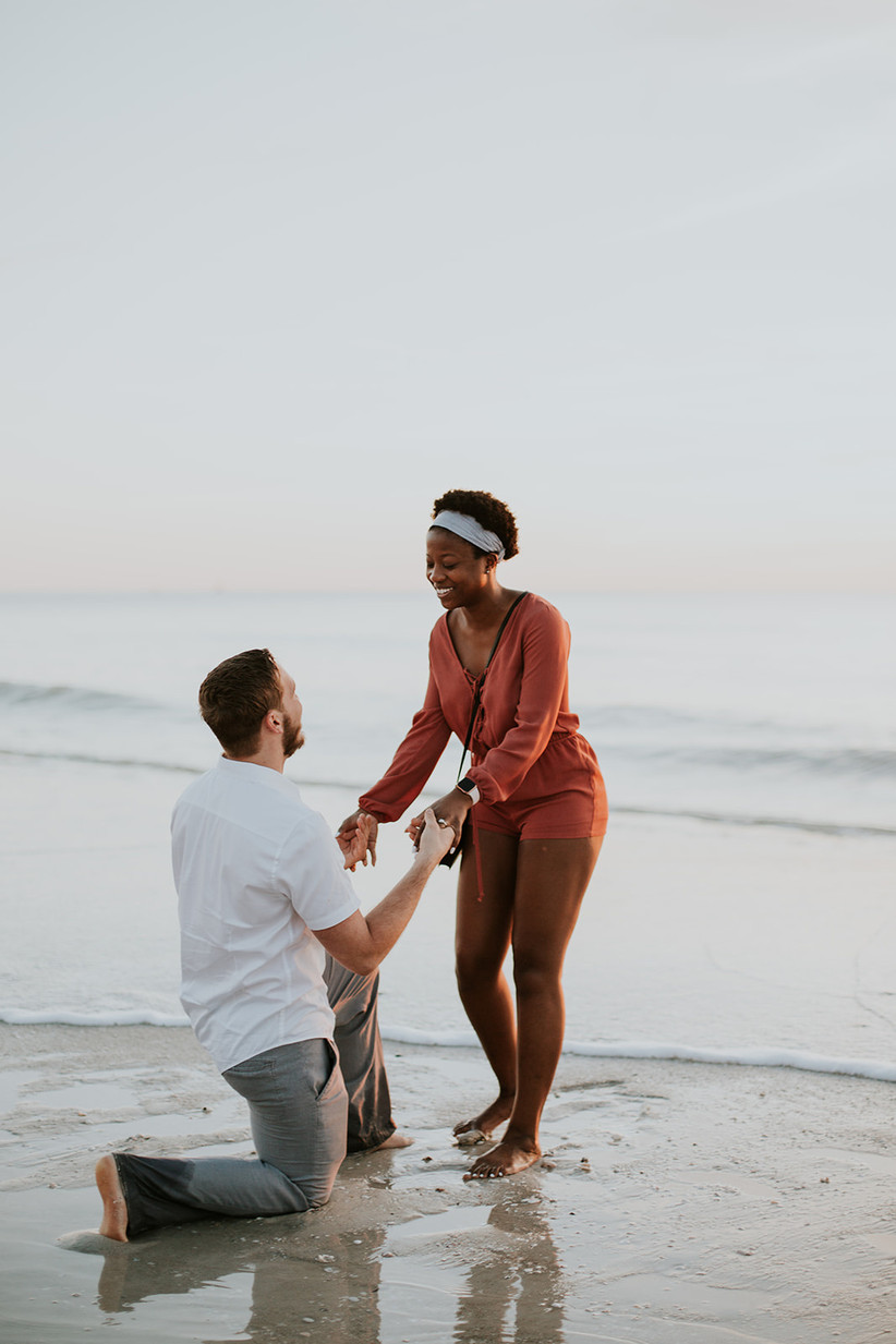beach proposal at sunset