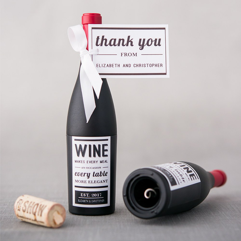Wine bottle-shaped corkscrew location-themed wedding welcome bag idea