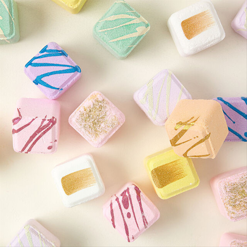 scented shower steam cubes in pastel colors