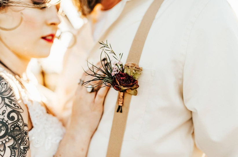 moody rustic wedding boutonniere with suspenders