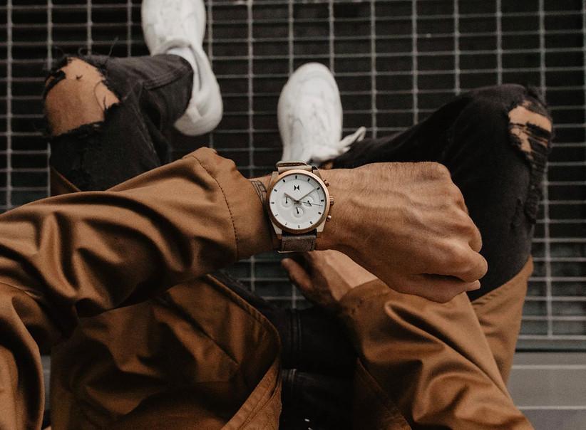 Man wearing sleek MVMT watch on wrist
