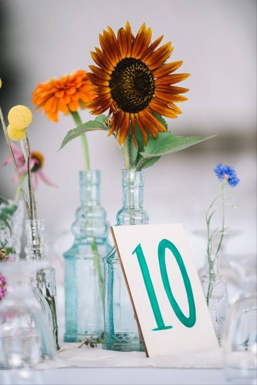 sunflower and wildflower wedding centerpiece with hand-painted table number