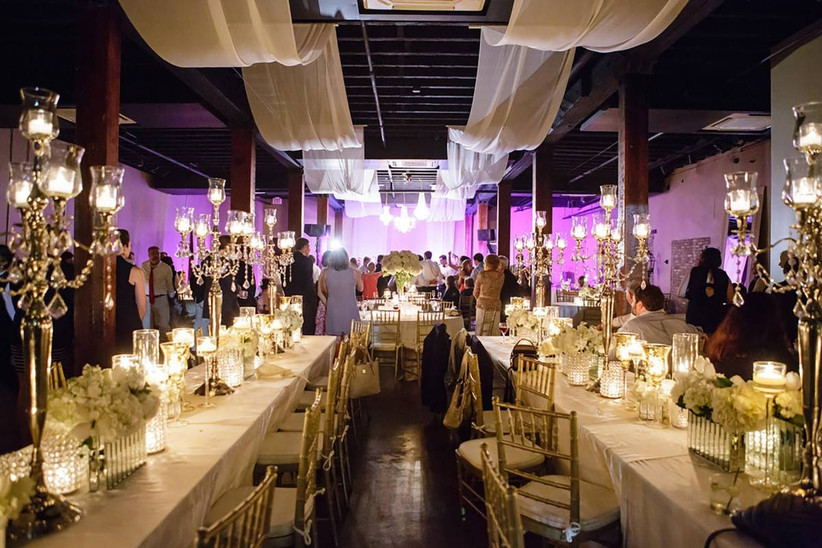 modern wedding reception with glamorous candelabra centerpieces and draped ceilings