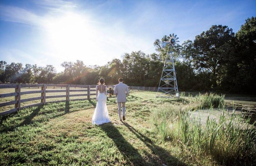 bride and groom walking at farm