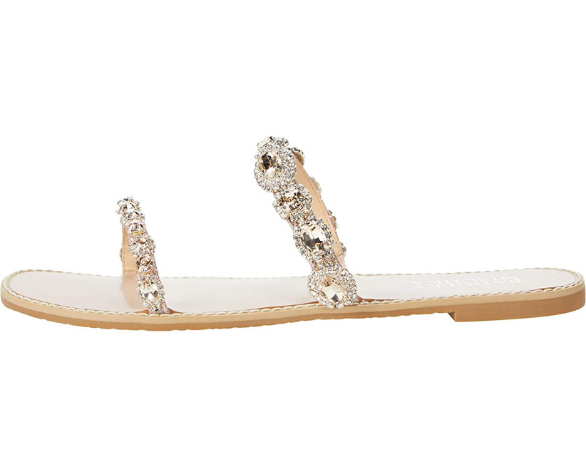 flat slip-on gold sandal with double beaded strap