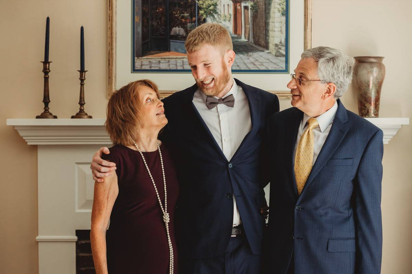 groom with arms around his parents