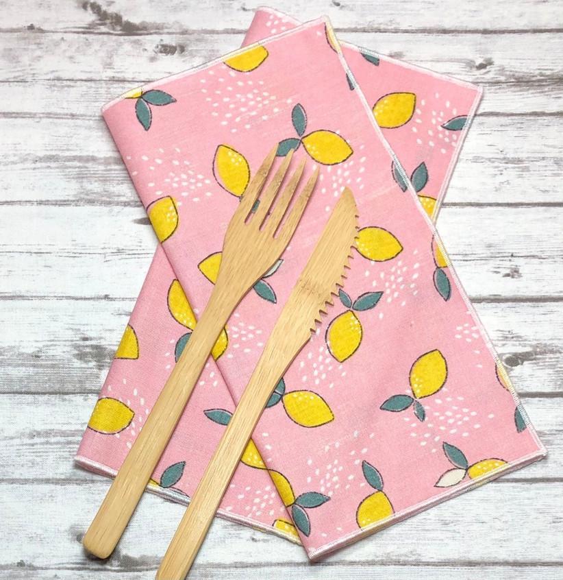 Pink cloth table napkins with cute lemon print