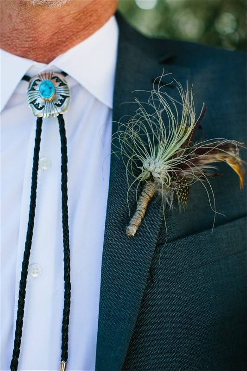 air plant and feather wedding boutonniere