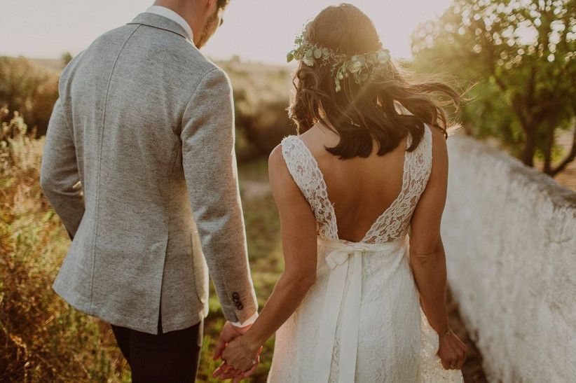 wedding couple holding hands and walking