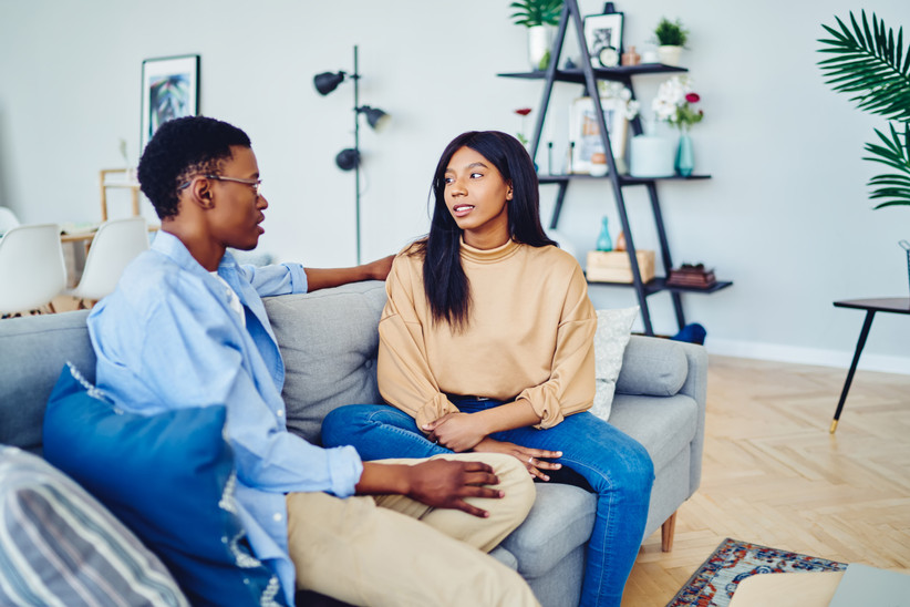 couple having a serious conversation at home