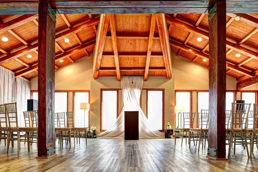 rustic las vegas wedding chapel with wooden pillars and vaulted barn-style ceiling