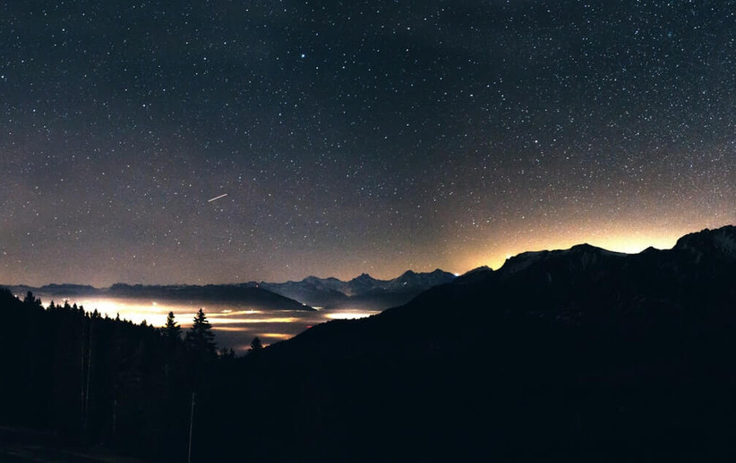 View of the night sky in nature with shooting star